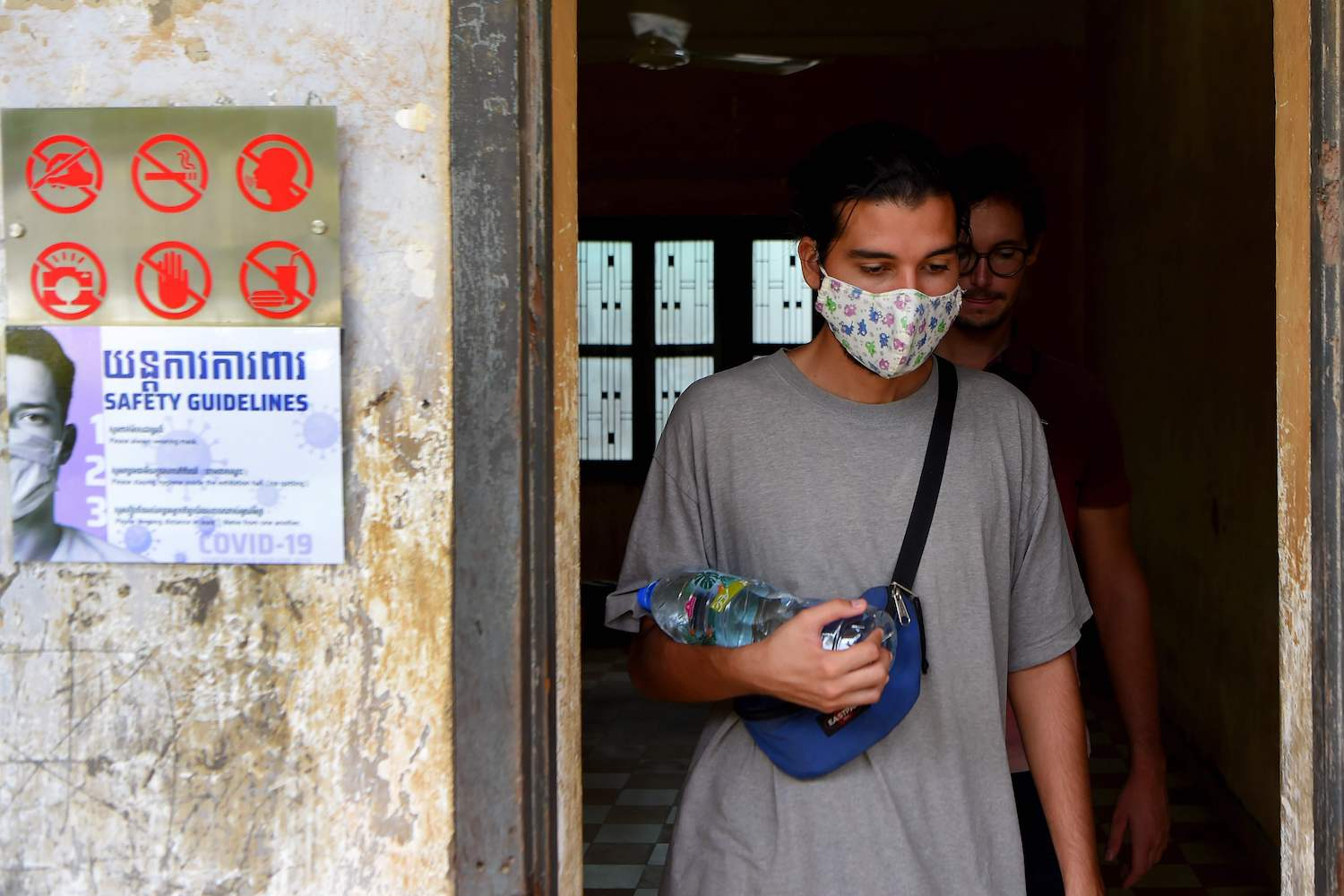 A tourist visits the reopened Tuol Sleng genocide museum in Phnom Penh on Monday. (AFP Photo)