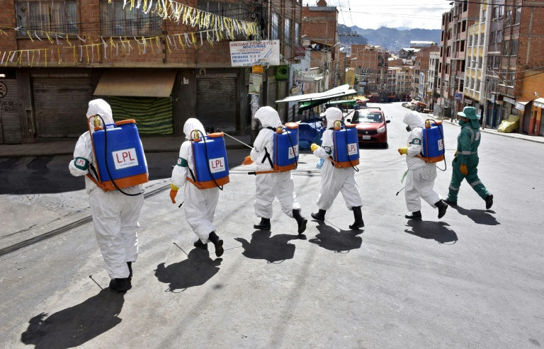 Municipal workers disinfect the streets of La Paz as a preventive measure to slow the spread of the novel coronavirus.