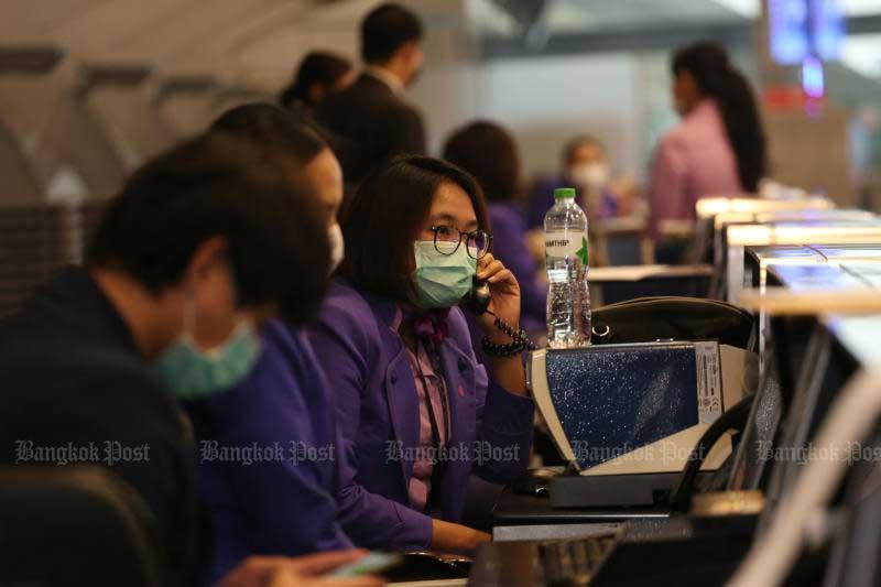 Thai Airways International staff at Suvarnabhumi airport prepare for ground handling services on May 26. 2020. (Photo by Varuth Hirunyatheb)