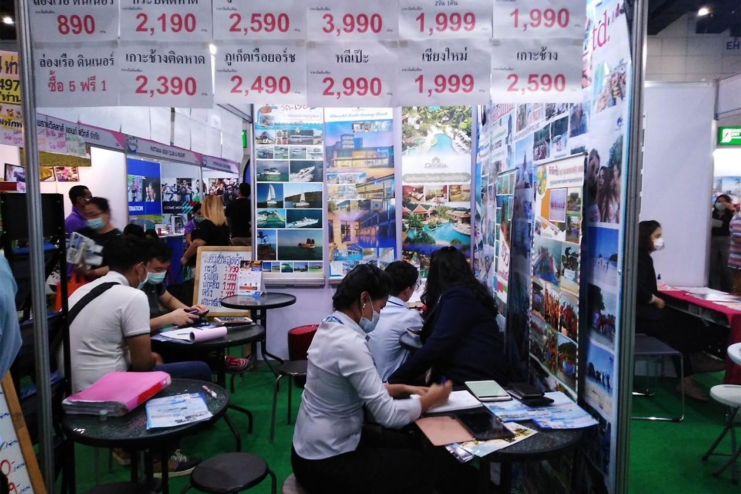 Domestic travel deals are displayed at a tourism fair. Tour operators would like more budget for designing flexible packages. (Bangkok Post photo)