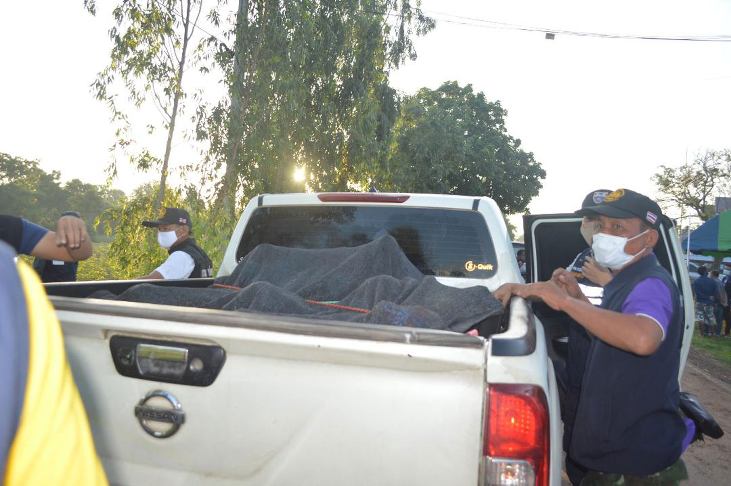 Illegal Cambodian migrants hide under a blanket on a pickup truck intercepted by officials at a checkpoint in Khok Sung district of Sa Kaeo. (Photo by Sawat Ketngam)