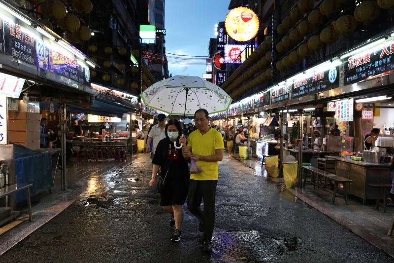 A woman wears a protective face mask to protect herself from contracting the coronavirus disease at a night market in Keelung, Taiwan, June 9, 2020. (Reuters photo)