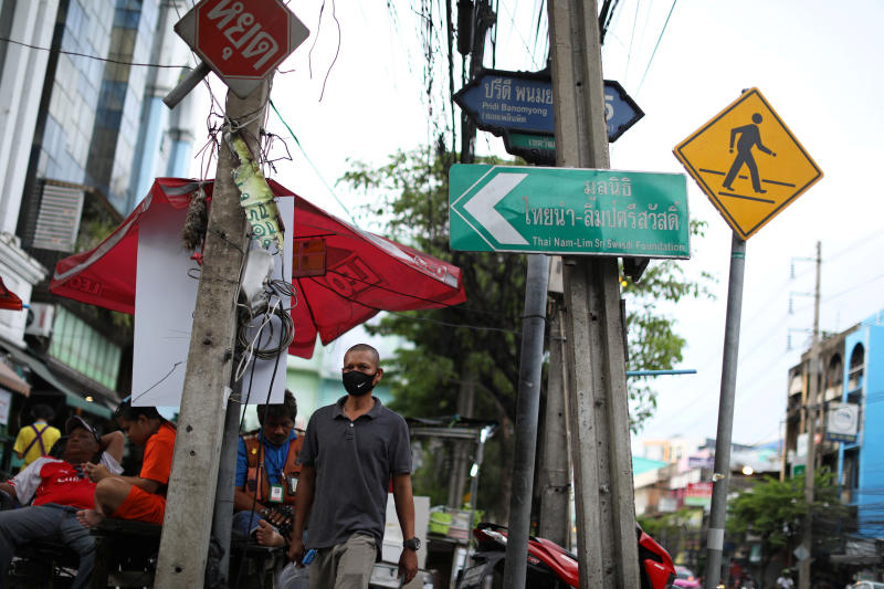 A man walks on Pridi Banomyong Road in Wattana district on Friday after the government eased some protective measures following the coronavirus disease outbreak. (Reuters photo)