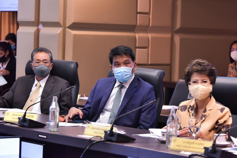 Former transport permanent secretary Supoj Saplom (left) is seen on June 15, 2020 at a meeting chaired by Justice Minister Somsak Thepsutin to discuss a project for rehabilitation and  development of inmates. (Justice Ministry photo)
