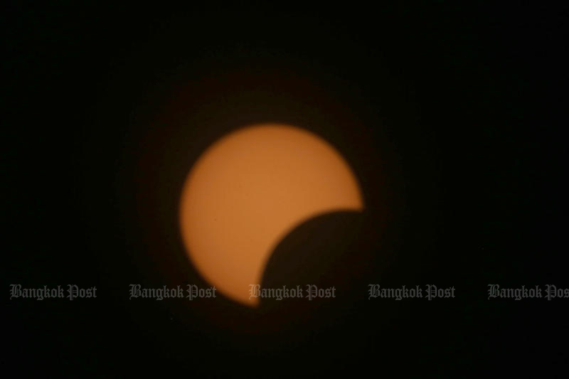 The moon moves in front of the sun, as seen from the observatory of the National Astronomical Research Institute of Thailand in Plaeng Yao district of Chachoengsao on Sunday. (Photo by Varuth Hirunyatheb)