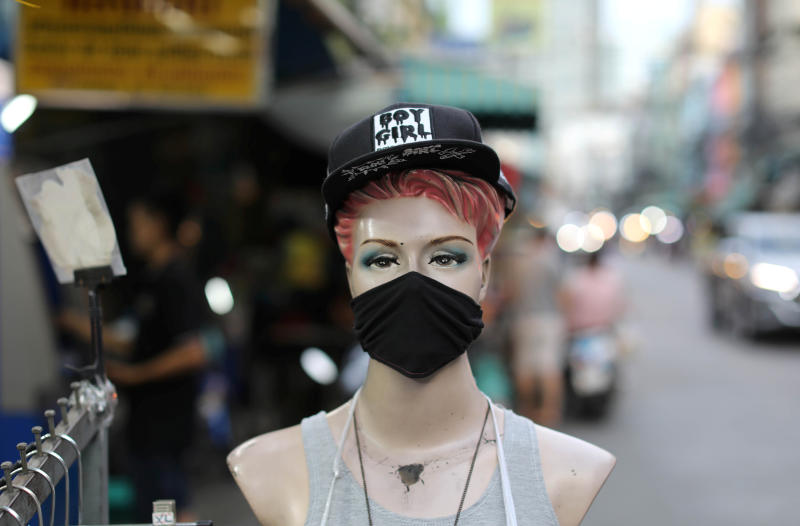 A mannequin wearing a protective face mask is seen after the government eased some protective measures following the coronavirus disease outbreak in Bangkok, on Friday. (Reuters photo)