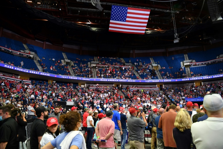 The upper section of the arena is seen partially empty as US President Donald Trump speaks during a campaign rally at the BOK Center