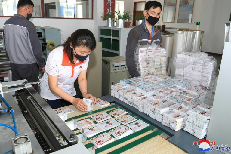 North Koreans prepare anti-Seoul leaflets at an undisclosed North Korean location, in an undated picture released by North Korea's official Korean Central News Agency on Saturday.