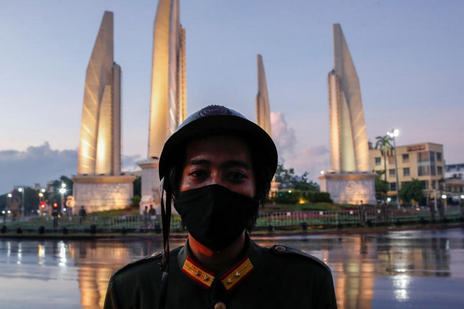 A protester dressed as a 1932 soldier takes part in a demonstration in front of the Democracy Monument in Bangkok on Wednesday, demanding changes to the constitution and marking the 88th anniversary of the 1932 revolt that ended the absolute monarchy in the country. (Photo: Reuters)
