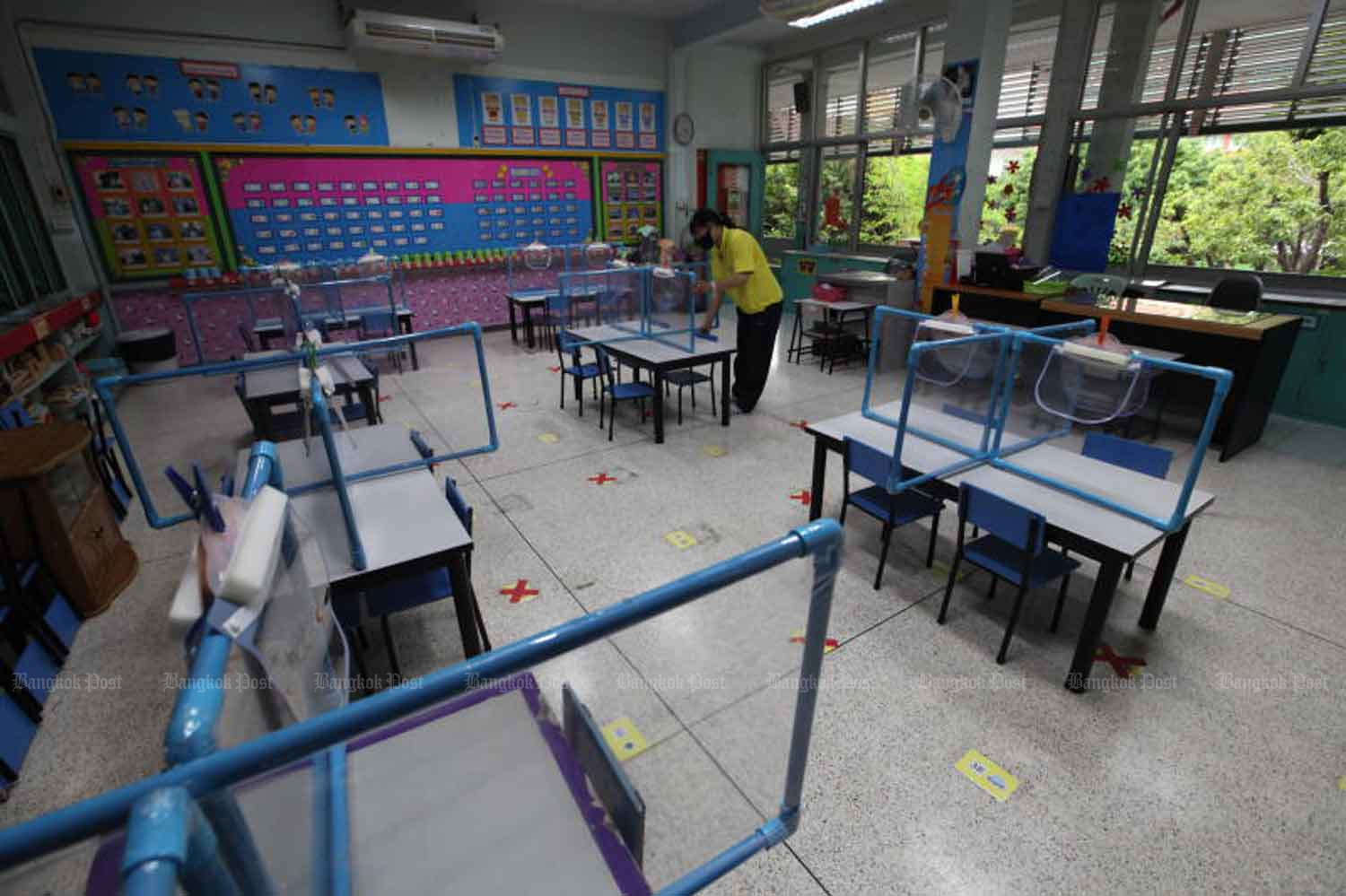 A teacher prepares a classroom for the new term, with careful arrangements to ensure the safety of pupils amid Covid-19 concerns, at Sri Iam Anusorn School in Bang Na district, Bangkok, on Tuesday. (Photo: Arnun Chonmahatrakool)