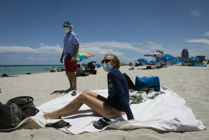 US states reimpose virus measures as cases spike
