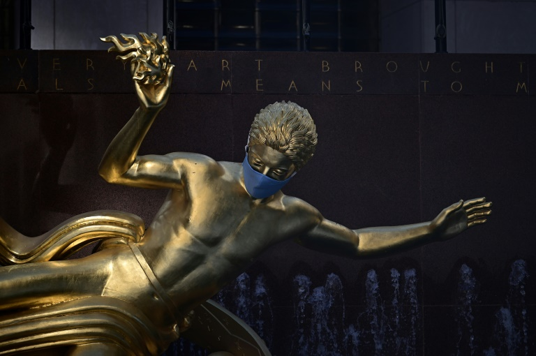 The sculpture of Prometheus adorned with a face mask is pictured at Rockefeller Center in Manhattan on June 24 in New York City.