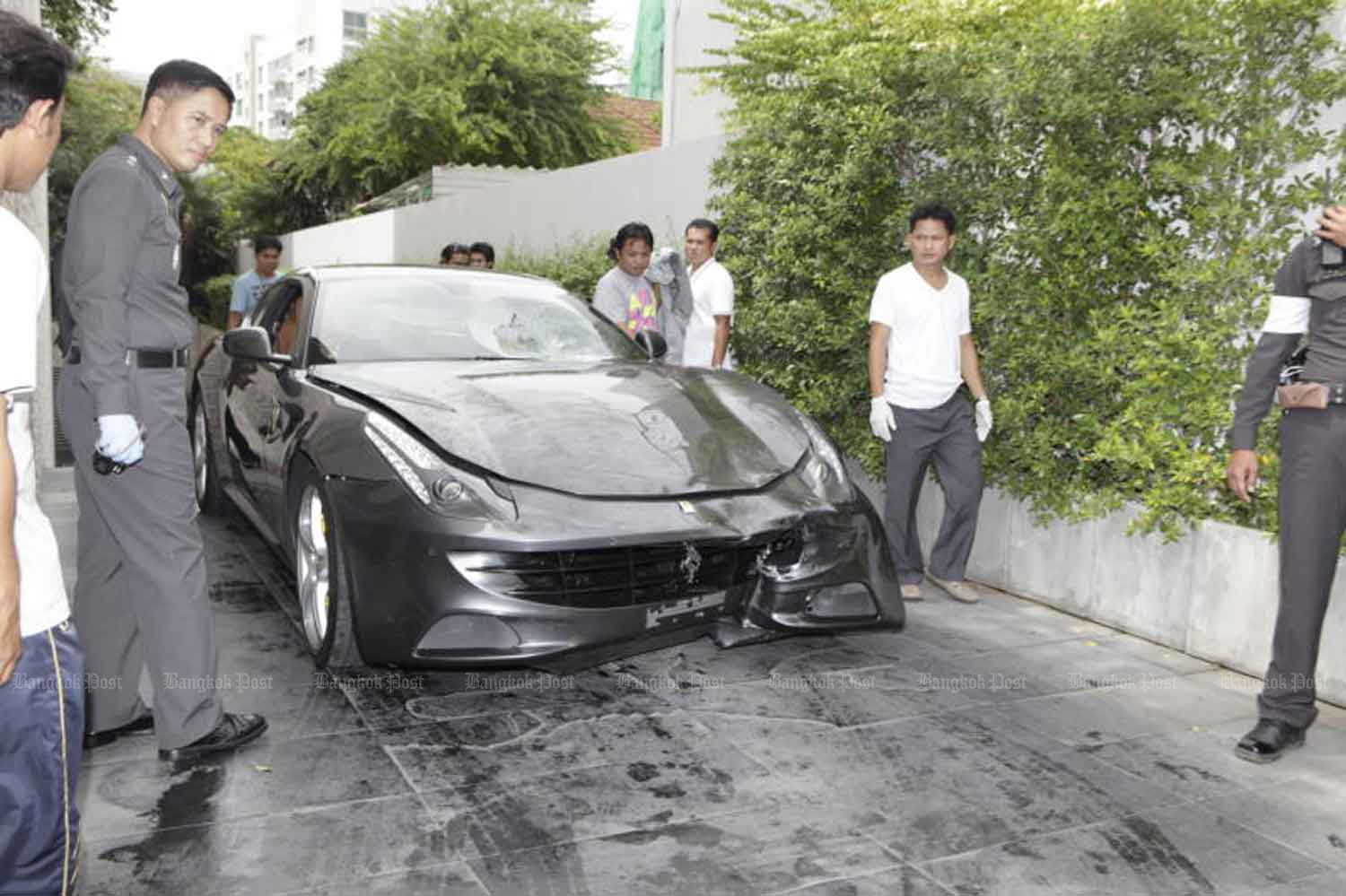 Vorayuth Yoovidhya's collision-damaged black Ferrari at the family home on Sukhumvit Soi 53 after the fatal accident in September 2012. (Photo by Kosol Nakachol)