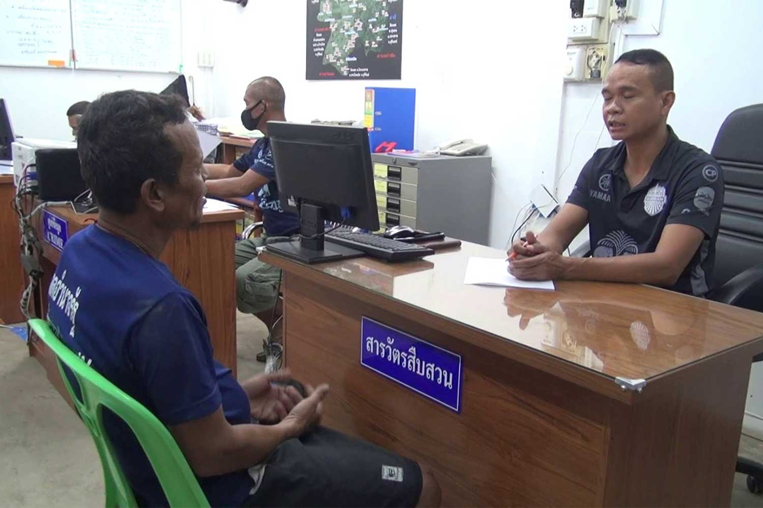 The 50-year-old suspect is interrogated by a police officer at Phlapphlachai police station in Buri Ram province, accused of raping a 9-year-old girl he claimed had fallen in love with him. (Photo: Surachai Piragsa)