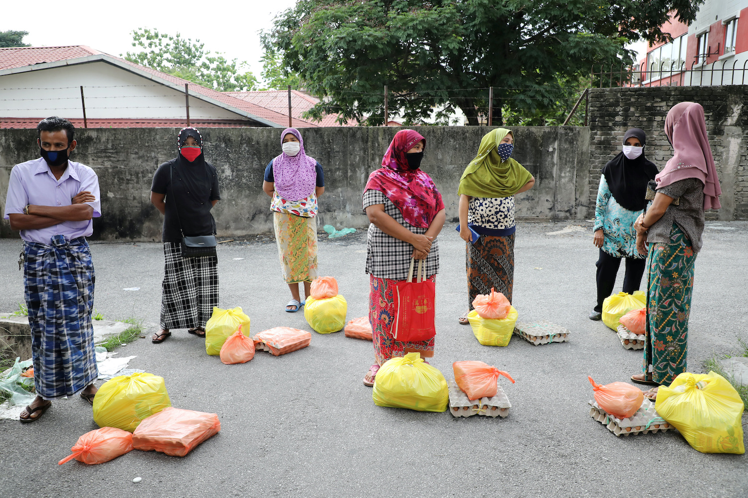 Rohingya refugees observe distancing while waiting to receive donated goods from volunteers in Kuala Lumpur in April. (Reuters Photo)