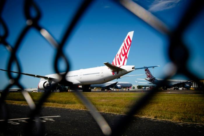 Bain wins bid to buy ailing Australian airline Virgin