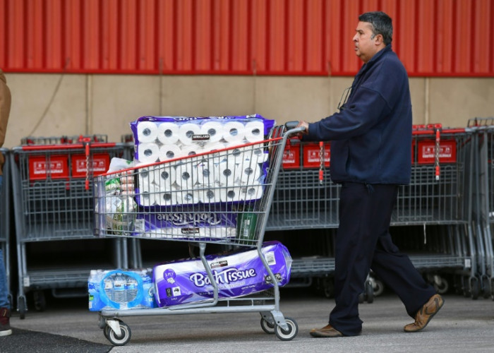 Toilet paper limits imposed in Australia to stop virus panic buying