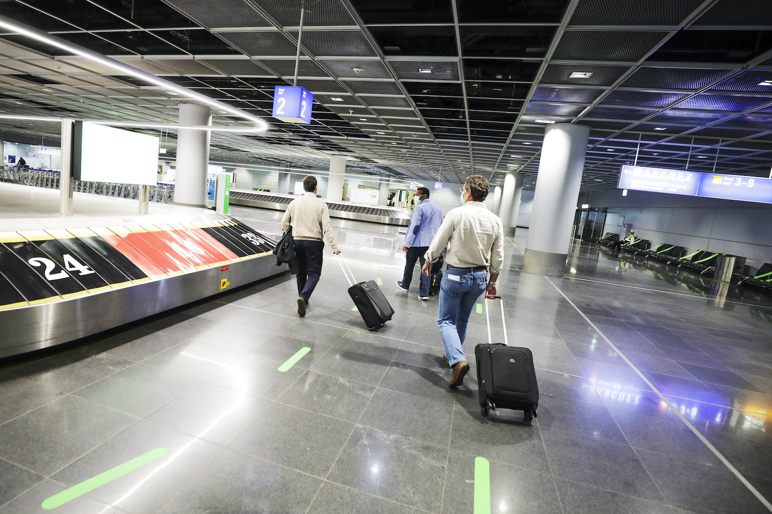 Travellers wheel luggage in the baggage-claim hall at Frankfurt Airport in Germany. (Bloomberg Photo)