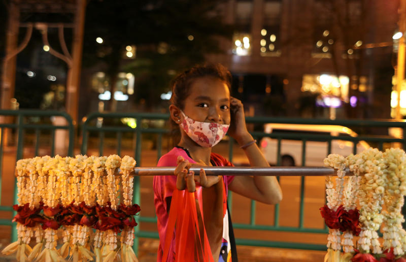 A girls sells flowers in downtown Bangkok on Friday. (Reuters photo)