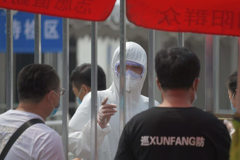 China records more COVID-19 cases as another phase of outbreak continues
