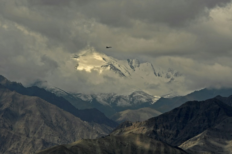 An Indian fighter jet flies over Leh, the joint capital of the union territory of Ladakh, on June 25, 2020, part of a show of strength after a border showdown between Delhi and Beijing.