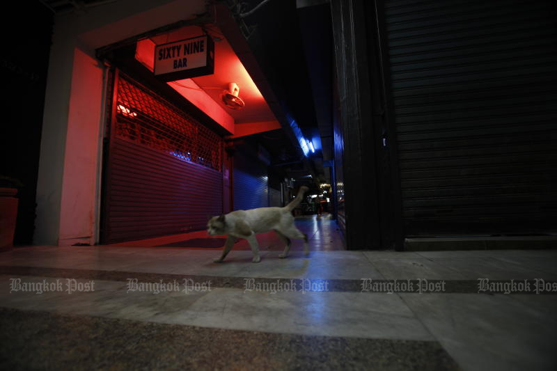 Night spots in the Patpong area of Bangkok remain shut due to the Covid-19 pandemic. They are among businesses being allowed to conditionally reopen on July 1. (Photo by Nutthawat Wicheanbut)
