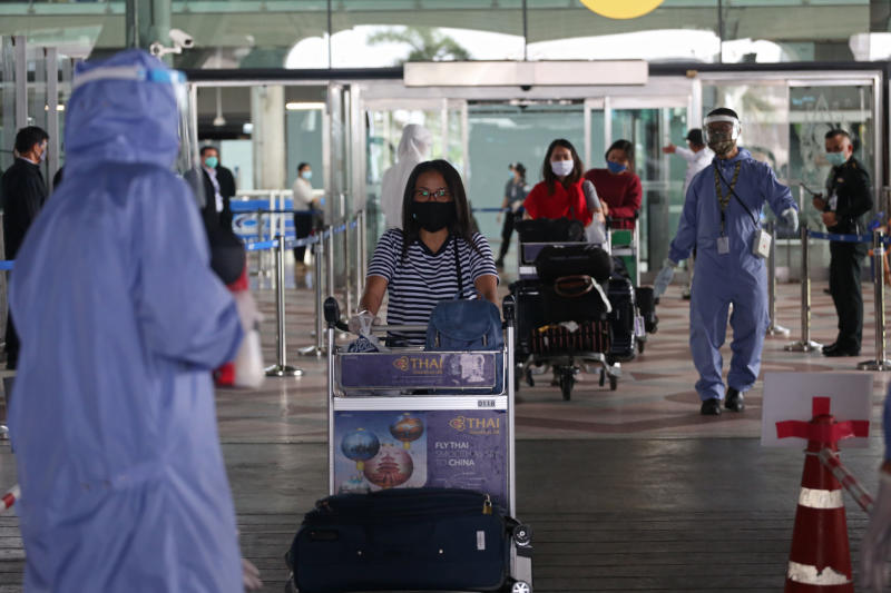 People arrive at Suvarnabhumi airport following a repatriation flight from the United Kingdom on June 14. (Bangkok Post file photo)