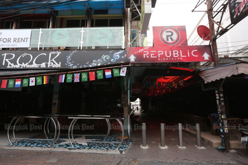 Walking Street in Pattaya is quiet now, but life is expected to return after pubs, bars and other entertainment facilities reopen their doors on Wednesday. (Photo: Wichan Charoenkiatpakul)