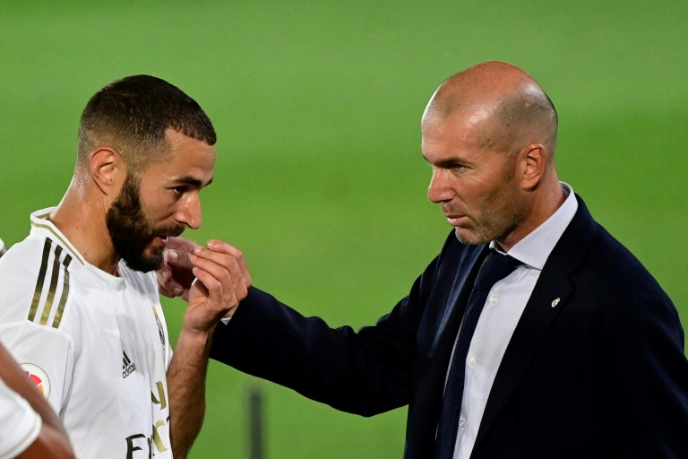 Moment of magic: Karim Benzema seen here with Real Madrid coach Zinedine Zidane.