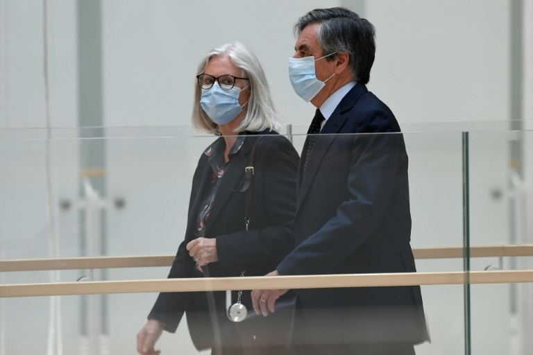 Former French prime minister Francois Fillon and his wife Penelope arriving at the Paris courthouse on Monday