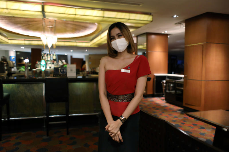 A hostess is seen at an empty bar in Royal Orchid Sheraton hotel in Bangkok on June 26. (Reuters photo)