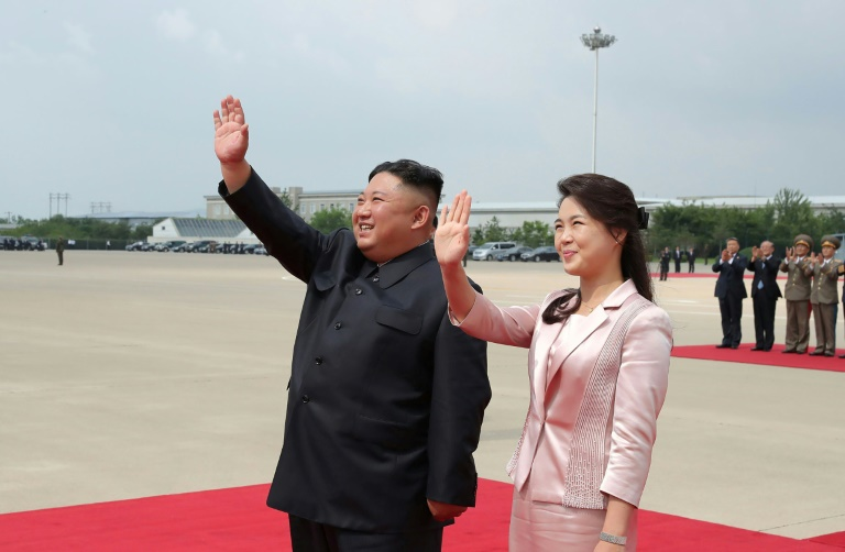 Anti-North Korea leaflets launched from the South included 'dirty, insulting' depictions of leader Kim Jong Un's spouse, Ri Sol Ju (right), Russia's ambassador said.