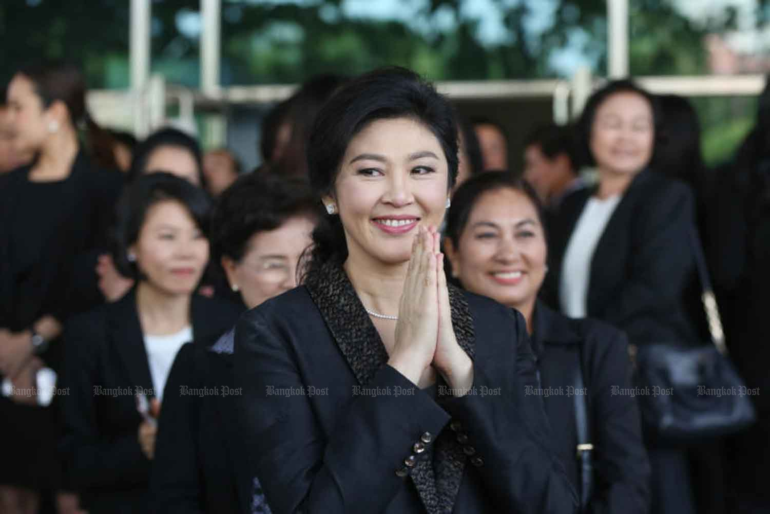 Former prime minister Yingluck Shinawatra outside the Supreme Court's Criminal Division for Holders of Political Positions in Bangkok during her trial for dereliction of duty  in 2017, shortly before she fled from Thailand. (Photo: Seksan Rojanamethakul)