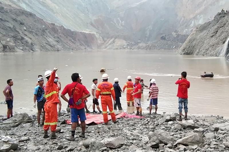 Rescuers attempting to locate survivors after a landslide at a jade mine in Hpakant, Kachin state, Myanmar on Thursday. (Myanmar Fire Services Department/AFP photo)