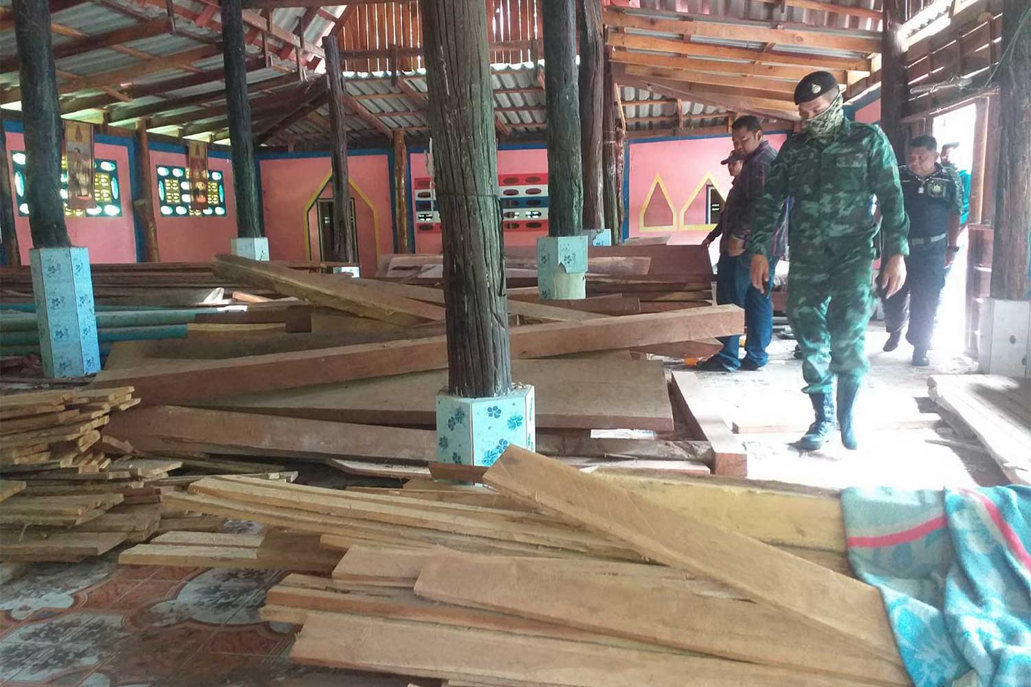Many illegally processed wood planks are found in the compound of Wat Nong Phla Sew in Sai Yok district, Kanchanaburi during a search on Thursday. (Photo: The Royal Forestry Department)
