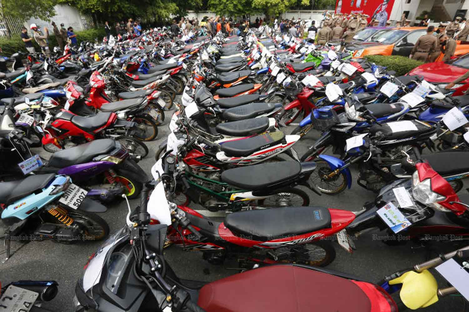 Dozens of motorcycles seized from illegal street racers are on display at the Provincial Police Region 1 in Chatuchak district of Bangkok on Thursday. (Photo: Pattarapong Chatpattarasill)