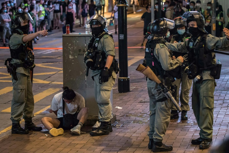 Riot police detain a man after they cleared protesters taking part in a rally against a new national security law in Hong Kong