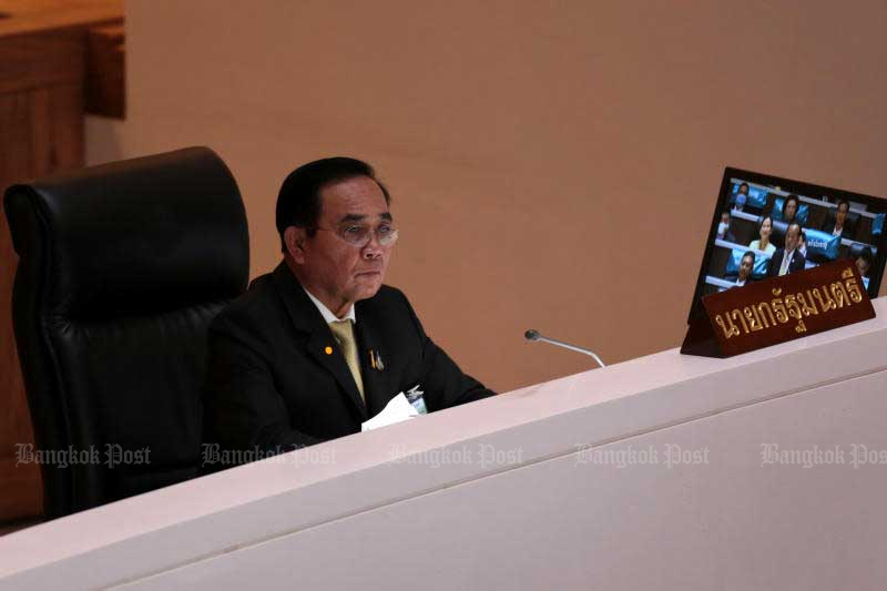 Prime Minister Prayut Chan-o-cha attends the draft budget bill debate in Parliament on Thursday. His government wins the first reading on Friday night. (Photo by Chanat Katanyu)