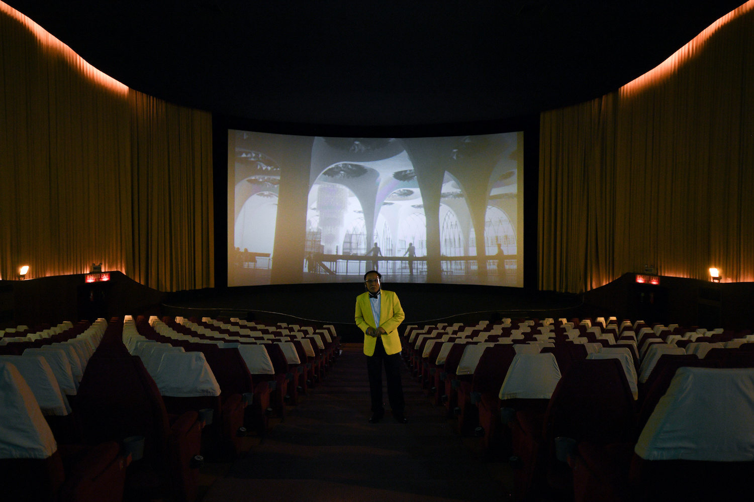 A nattily attired cinephile surveys the cinema on Saturday as the Scala counts down to its final curtain. (Reuters/Chalinee Thirasupa)