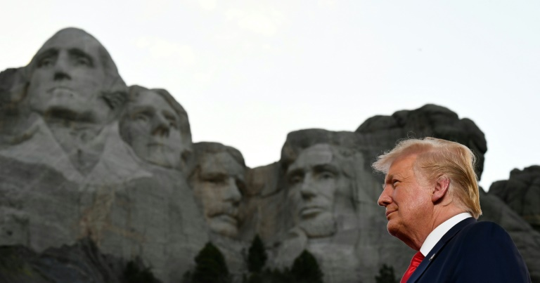 As US struggles with virus, Trump heads to Rushmore for fireworks