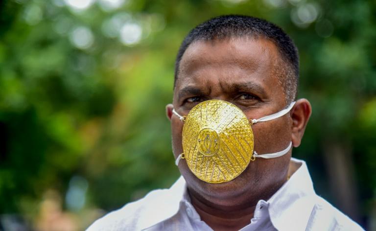 Shankar Kurhade wearing his gold face mask