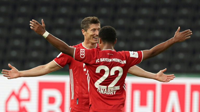 Bayern Munich striker Robert Lewandowski celebrates his long-range goal in the German Cup final win over Bayer Leverkusen on Saturday in Berlin.