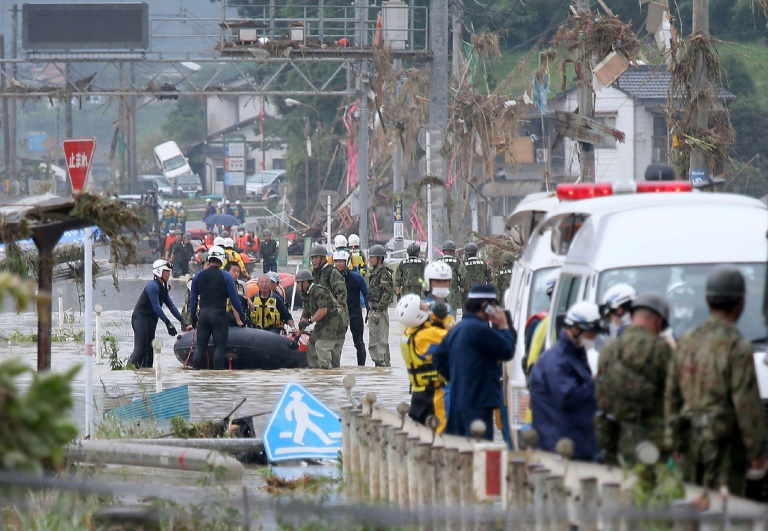 Rescuers are searching for 14 people missing after floods hit the Kumamoto region on Japan's southwestern island of Kyushu.