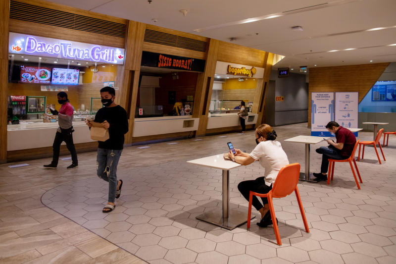 Diners wait for their orders at a food court in Mandaluyong City, Metro Manila, where only one customer per table is allowed on June 16, 2020. (Reuters photo)