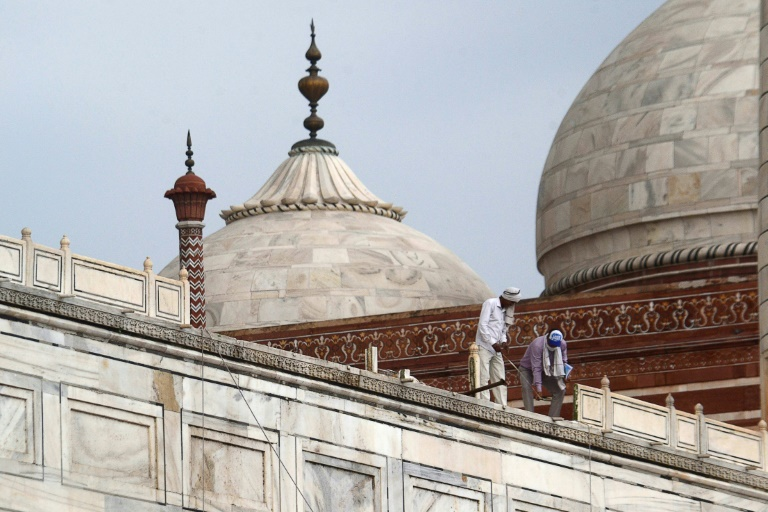 A close-up view of India's top tourist attraction, the Taj Mahal, where workers stood on the railing on May 30, 2020 after damage from a heavy rainstorm while the site remained closed to visitors during the coronavirus pandemic.