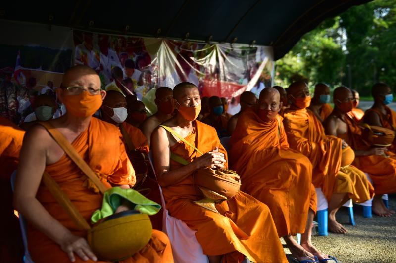 Monks attend an event to mark Asalha Bucha Day in the southern province of Narathiwat on Sunday, amid restrictions due to the Covid-19 coronavirus. (AFP photo)