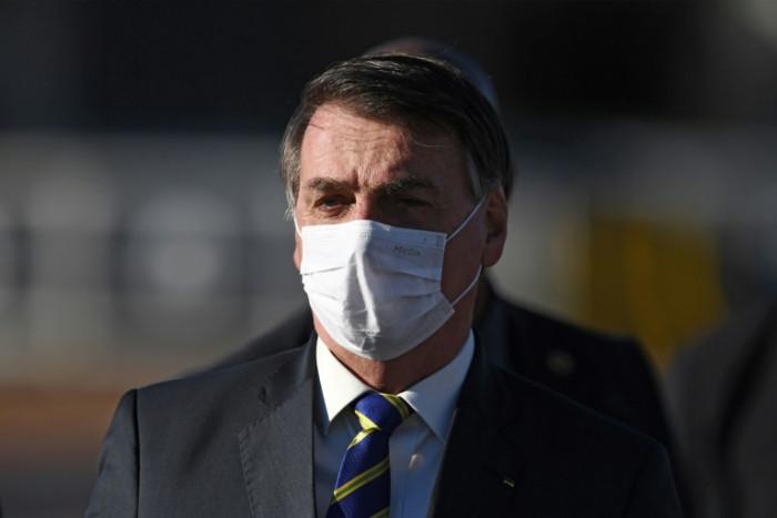 Brazil's Bolsonaro takes virus test after showing symptoms