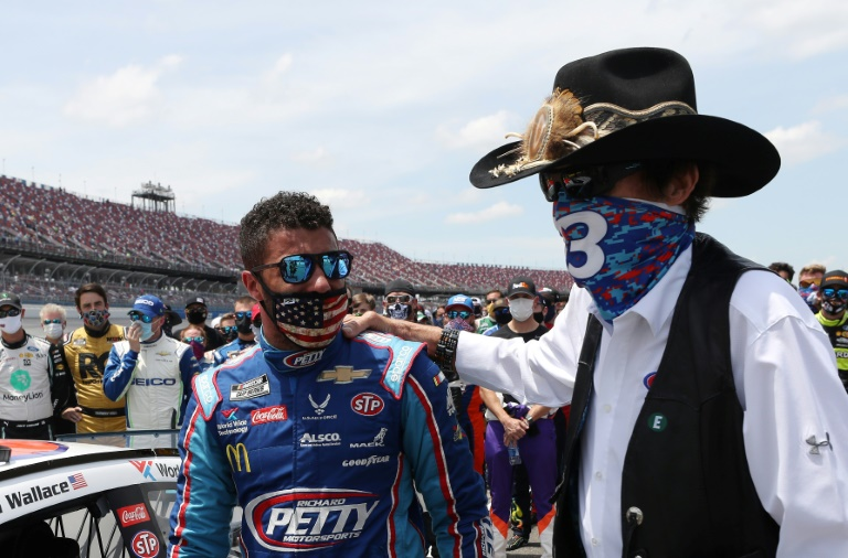 NASCAR's only African American full time driver Bubba Wallace (left) successfully campaigned for a ban on flying the Confederate flag at races.