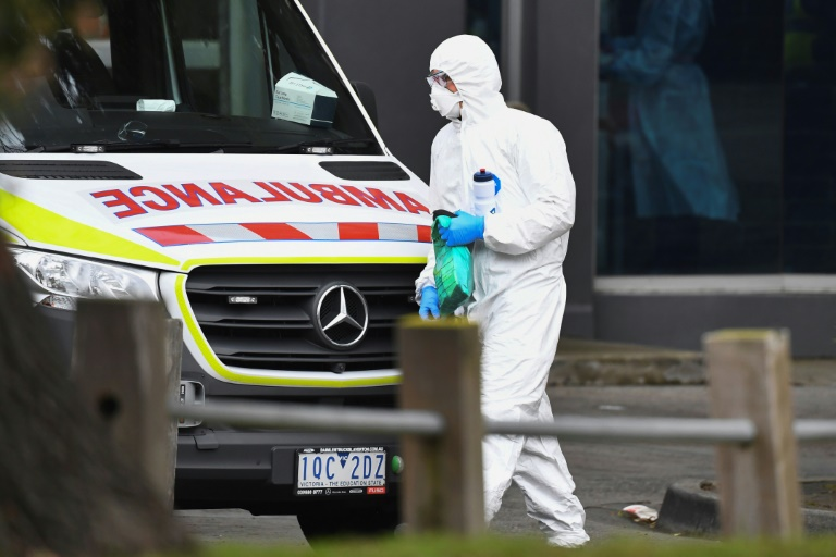 An ambulance is seen outside one of nine public housing estates locked down due to a spike in COVID-19 coronavirus numbers in Melbourne