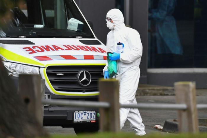 Australia locks down millions as US struggles to contain virus